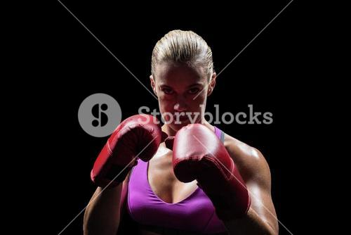 Portrait of woman fighter with gloves