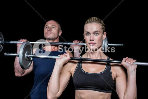 Woman and man lifting crossfit