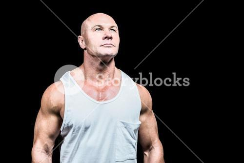 Bodybuilder in vest looking up