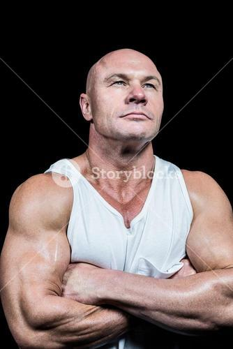 Confident bodybuilder with arms crossed