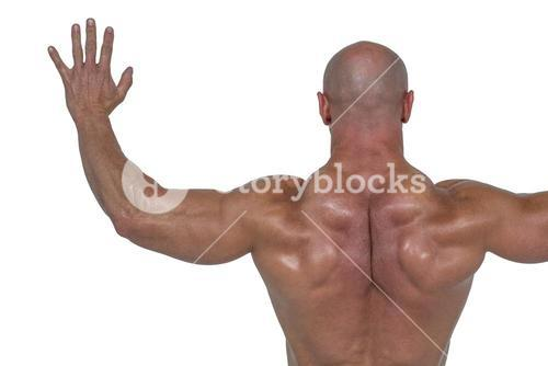 Rear view of bodybuilder with arms outstretched