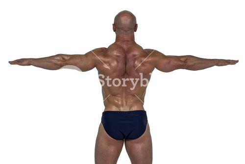 Rear view of muscular man exercising with hands