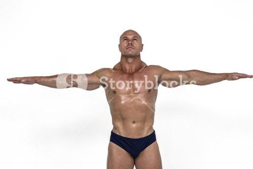 Muscular man with arms outstretched