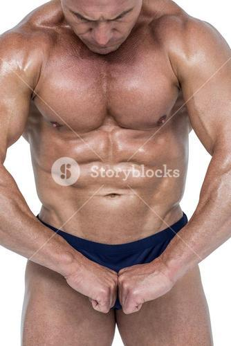 Powerful athlete flexing muscles