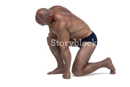 Athlete exercising while kneeling down