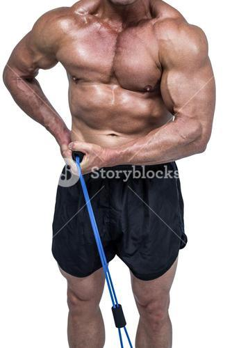Midsection of bodybuilder pulling elastic rope
