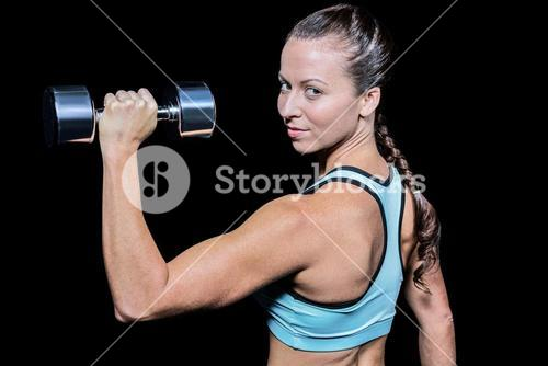 Portrait of woman lifting dumbbell