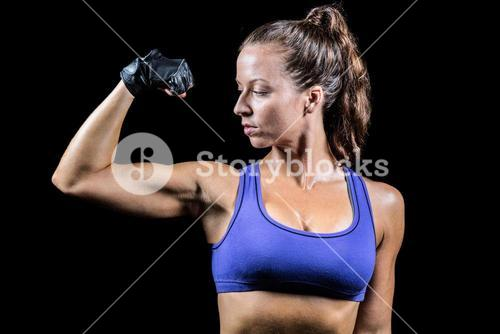Confident woman flexing muscles