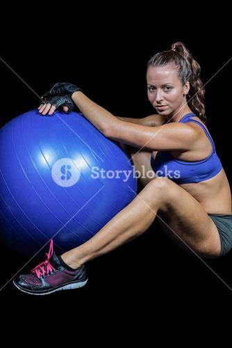 Sporty woman with exercise ball