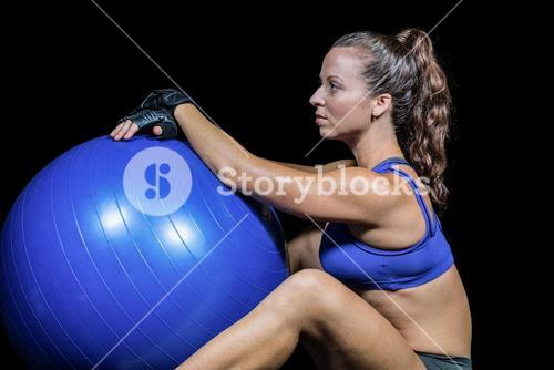 Side view of sporty woman with exercise ball
