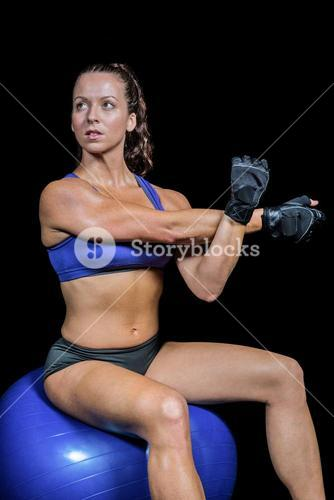 Athlete working out on exercise ball