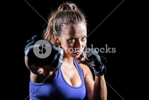 Portrait of female fighter punching