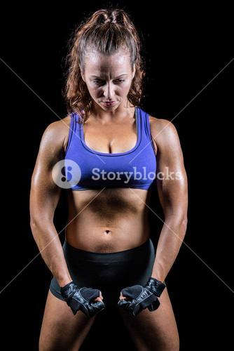 Female fighter flexing muscles