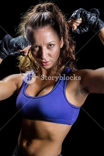 Portrait of bodybuilder with fighting stance