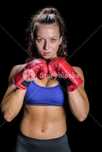 Portrait of pretty woman with fighting stance