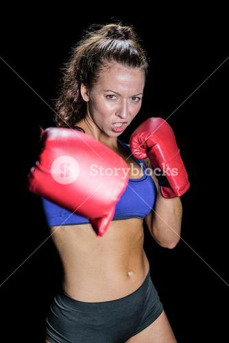 Angry female fighter with gloves