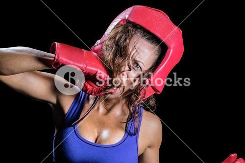 Portrait of crazy fighter punching herself