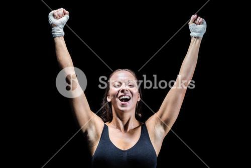 Happy winner with arms raised