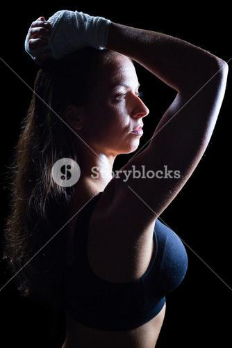 Side view of thoughtful athlete with hands on head