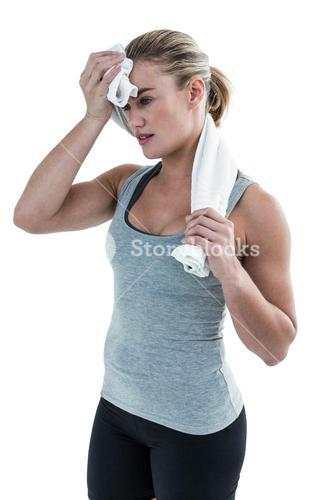 Muscular woman wiping herself with towel