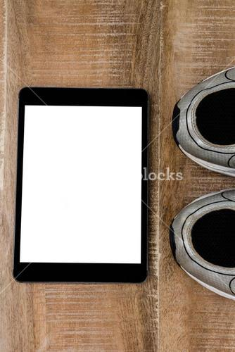 Tablet pc with running shoes