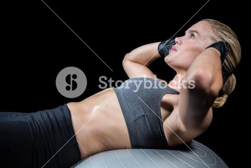 Muscular woman doing sit ups