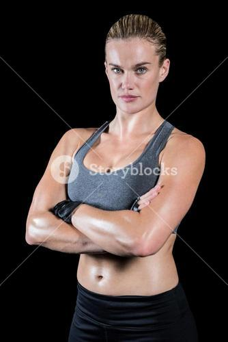 Muscular woman with arms crossed