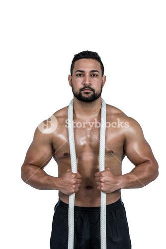 Muscular man with battle rope