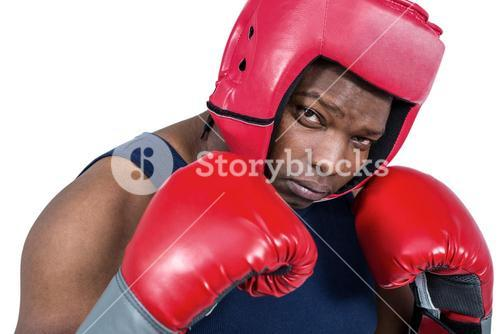 Fit man boxing with gloves