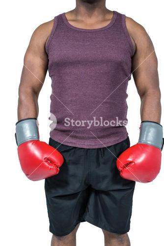 Fit man with boxing gloves