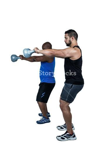 Strong friends lifting kettlebells together