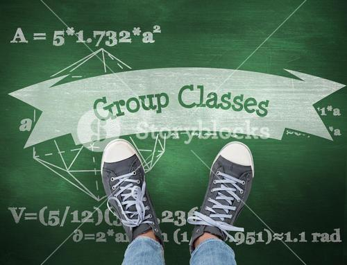 Group classes against green chalkboard