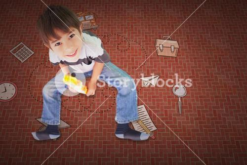 Composite image of cute boy sitting with building blocks
