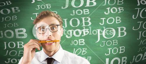 Composite image of geeky businessman biting a pencil