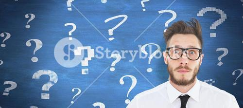 Composite image of geeky young businessman looking at camera