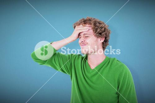Composite image of anxious casual man standing with hand on forehead