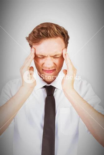Composite image of young businessman getting a headache