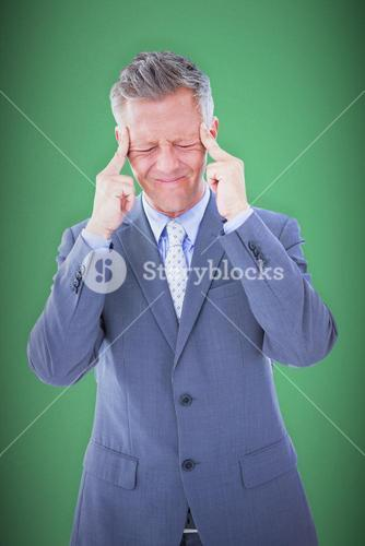 Composite image of businessman with headache
