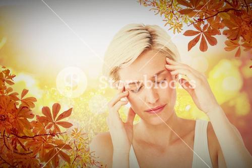 Composite image of pretty blonde with headache touching her temples