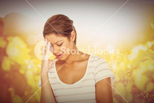 Composite image of upset woman suffering from headache