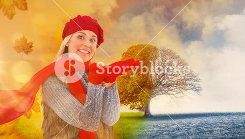 Composite image of blonde in winter clothes with hands out
