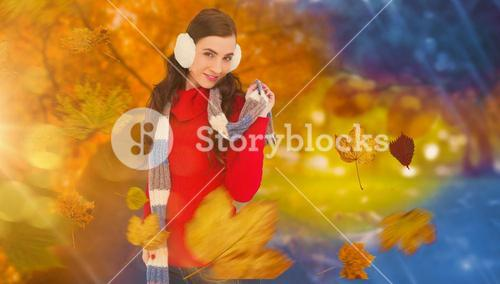 Composite image of happy brunette in winter clothes posing
