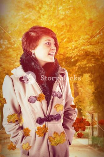 Composite image of smiling beautiful woman in winter coat