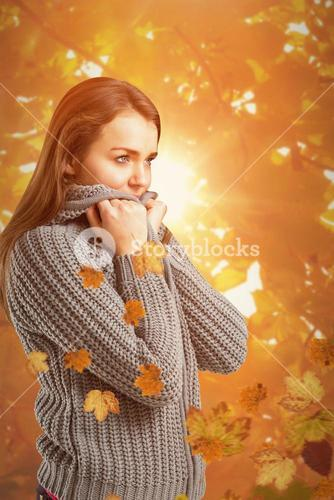 Composite image of pretty girl in winter jumper