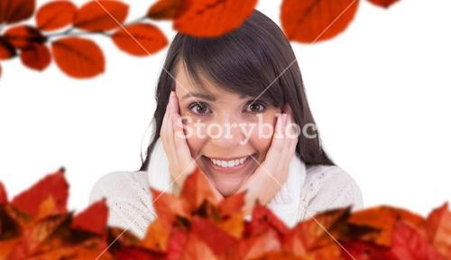 Composite image of brunette in winter clothes smiling at camera