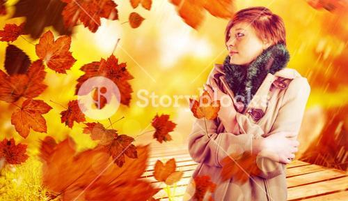 Composite image of thoughtful woman in winter coat