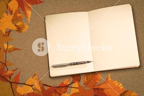 Composite image of notebook and pen