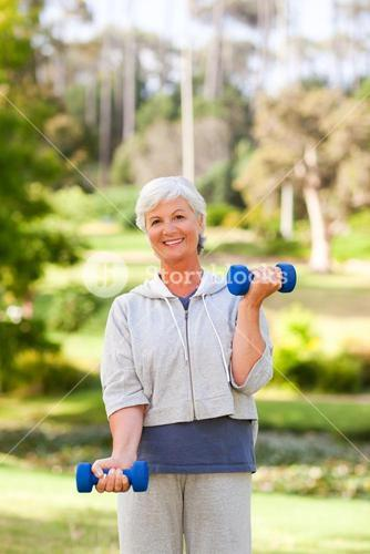 Mature woman doing her exercises in the park