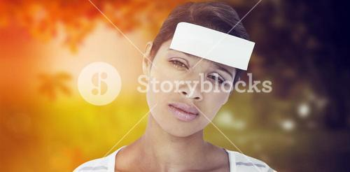 Composite image of portrait of upset woman with blank note on forehead