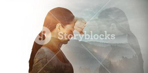 Composite image of sad woman leaning against the wall